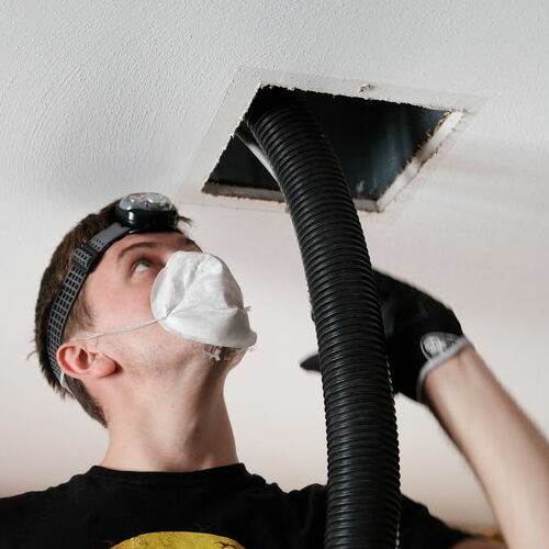 A Technician Cleans an Air Duct.