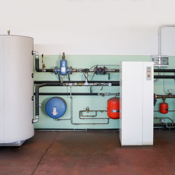 pumps in a basement for geothermal heat